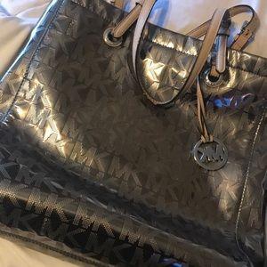 Micheal Kors silver metallic purse